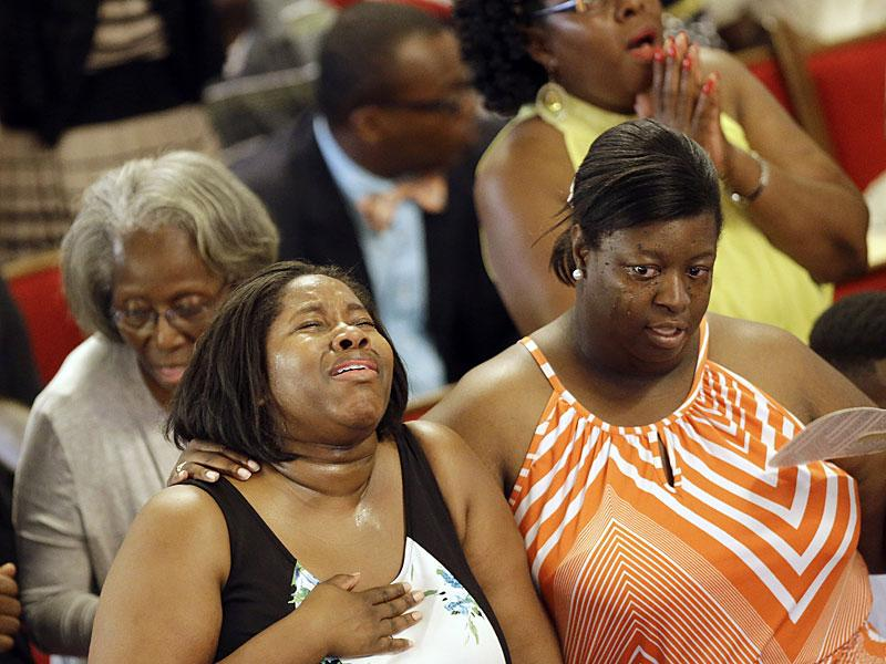 Parishioners sing at the Emanuel A.M.E Church, four days after a mass shooting that claimed the lives of its pastor and eight others on in Charleston, SC. (AP Photo)