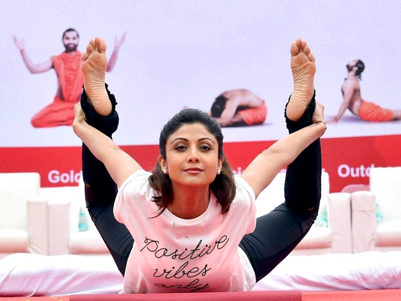 Shilpa Shetty Kundra performs Yoga during a mass yoga session in Bengaluru. (Photo: PTI)