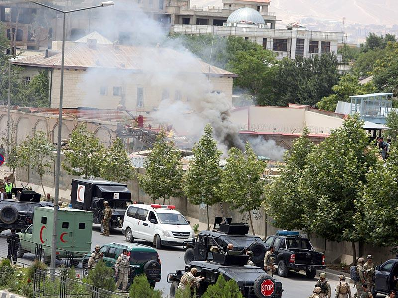 Smoke rises at the site of a suicide attack during clashes with Taliban fighters in front of the Parliament in Kabul. (AP Photo)