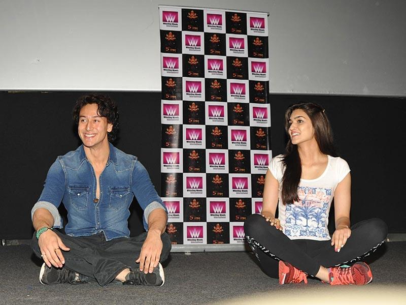 Actors Kriti Sanon and Tiger Shroff after the mass yoga session to mark the International Yoga Day at Whistling Woods in Mumbai, on June 21, 2015.(IANS Photo)