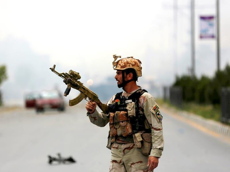 A member of Afghan security forces holds a rifle at the site of the suicide attack near the Afghan Parliament. (Reuters Photo)