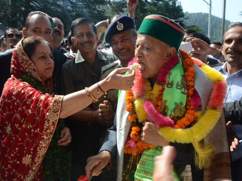 Chief minister Virbhadra Singh's wife Pratibha Singh offering cake to him during his 81st birthday in celebrations in Shimla on Tuesday. Santosh Rawat/HT