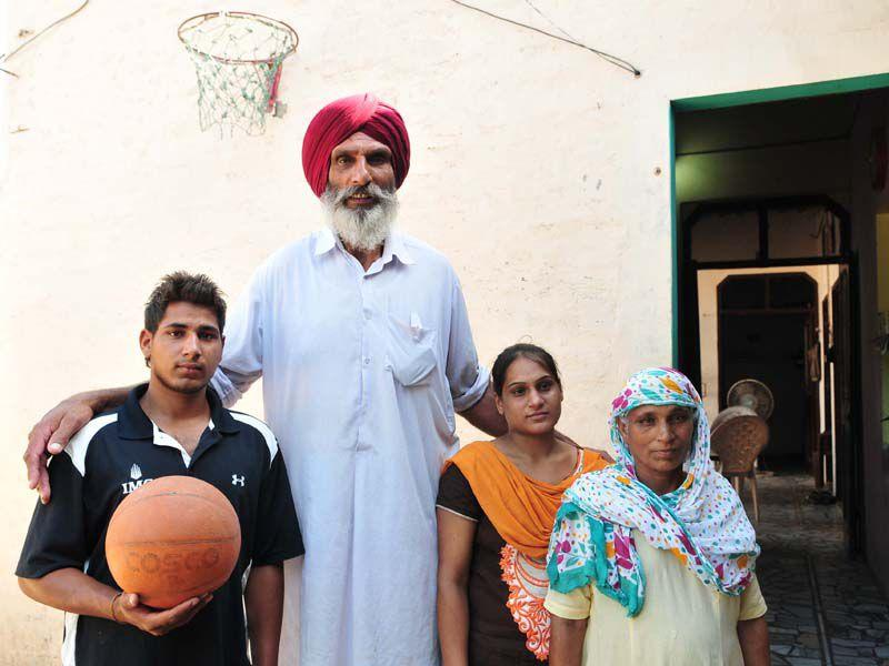 Family members of basketball player Satnam Singh at village Ballo Ke, Barnala Punjab on Friday. Keshav Singh/HT