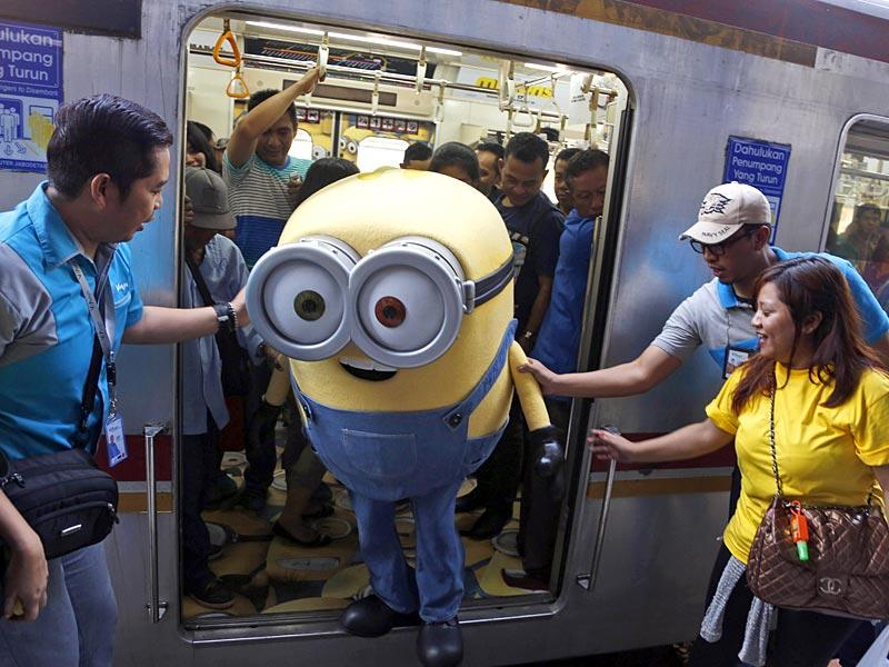 A minion takes a metro in Indonesia, everybody has a good time. (AP photo)