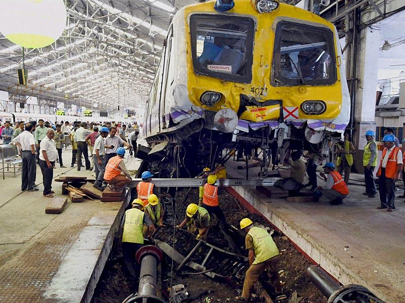 Officials of Accident Relief Train (ART) at work after a local train got derailed and got onto the concourse at the Churchgate station in Mumbai on Sunday (PTI Photo)