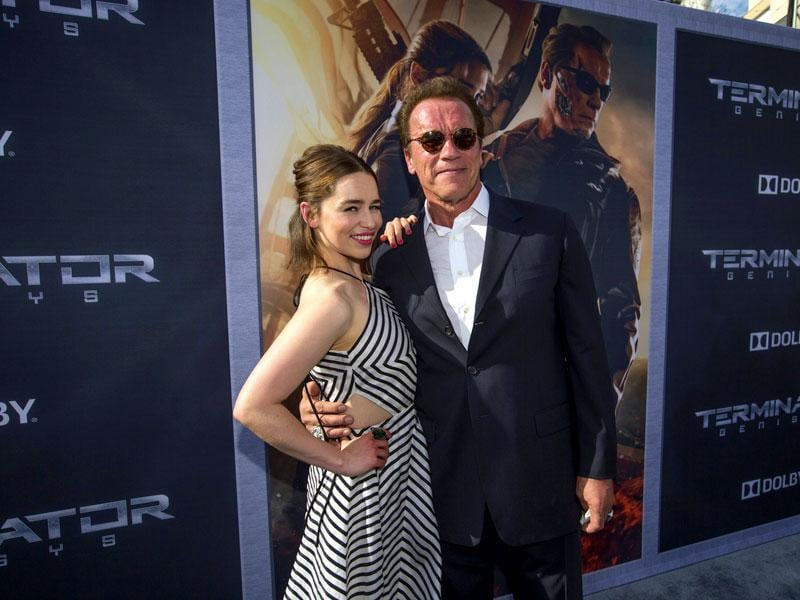 Arnold Schwarzenegger poses with Emilia Clarke at the premiere of Terminator: Genisys. (Reuters)