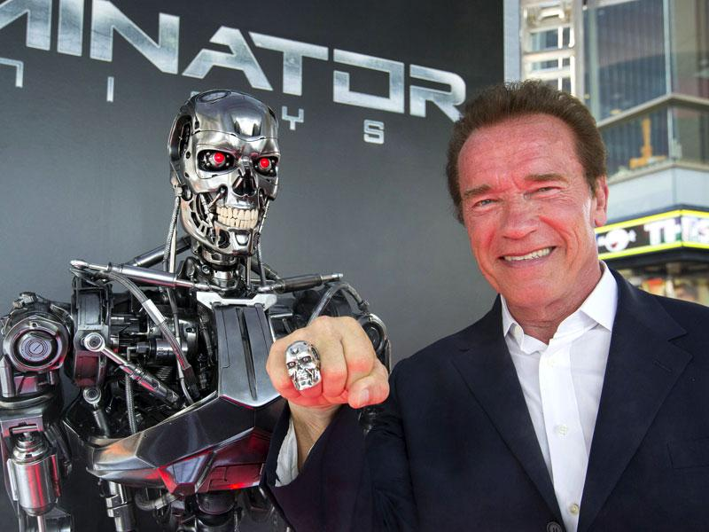 And he's back: Arnold Schwarzenegger poses at Terminator Gen isys premiere in California. (Reuters)