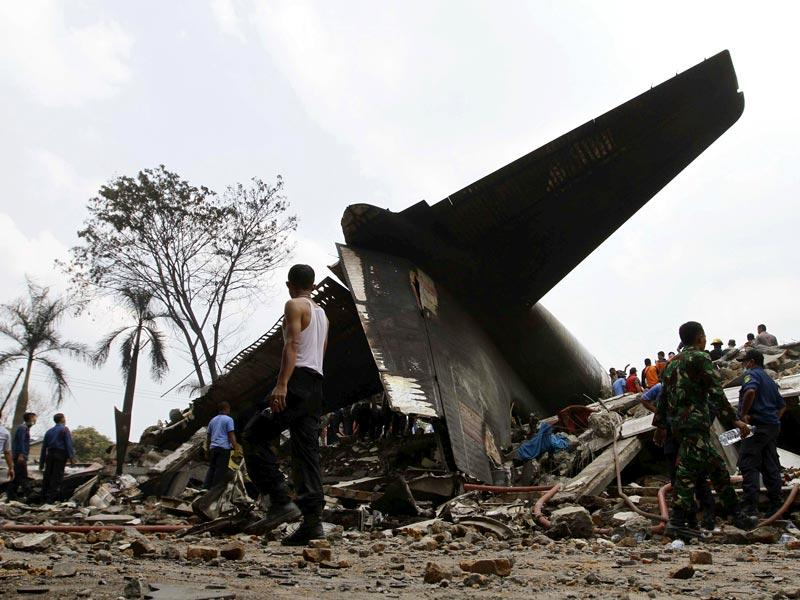 Security forces and rescue teams examine the the wreckage at the crash site, in the North Sumatra city of Medan, Indonesia (Reuters Photo)