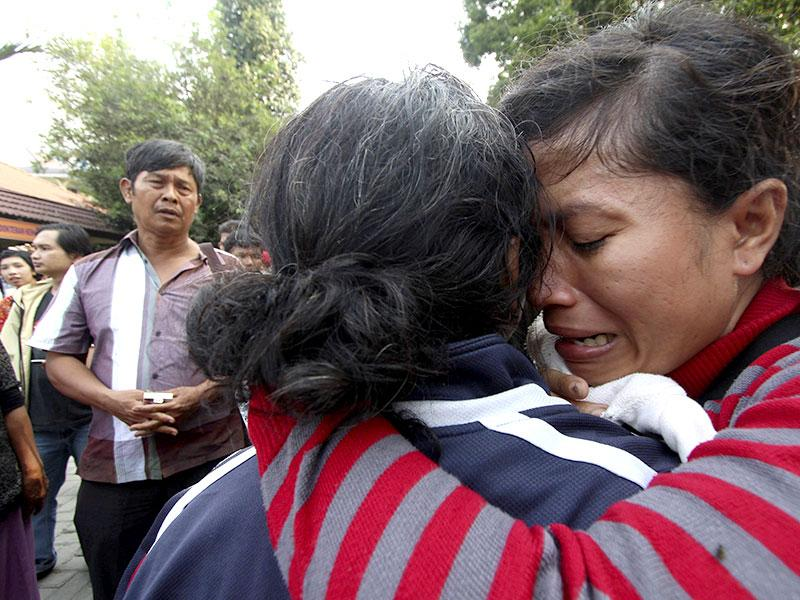 A family member of a victim from an Indonesian military C-130 Hercules transport plane that crashed into a residential area (Reuters Photo)