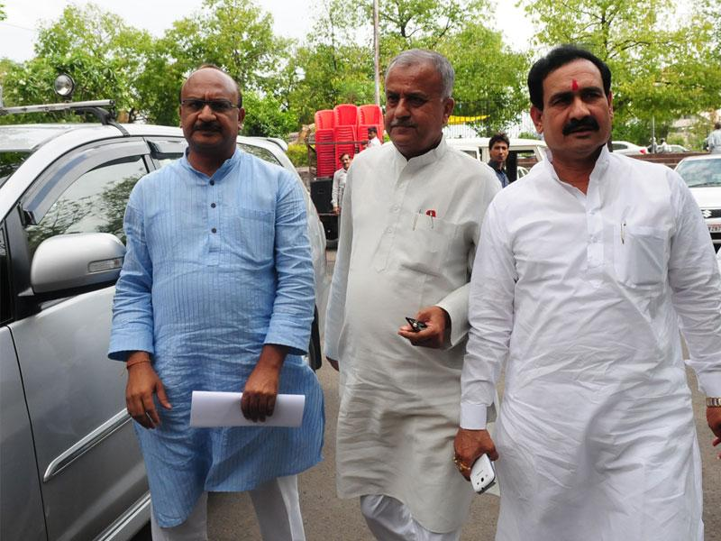 BJP state president Nand Kumar Singh Chauhan along with health minister Narottam Mishra at SIT office. (Mujeeb Faruqui/HT photo)