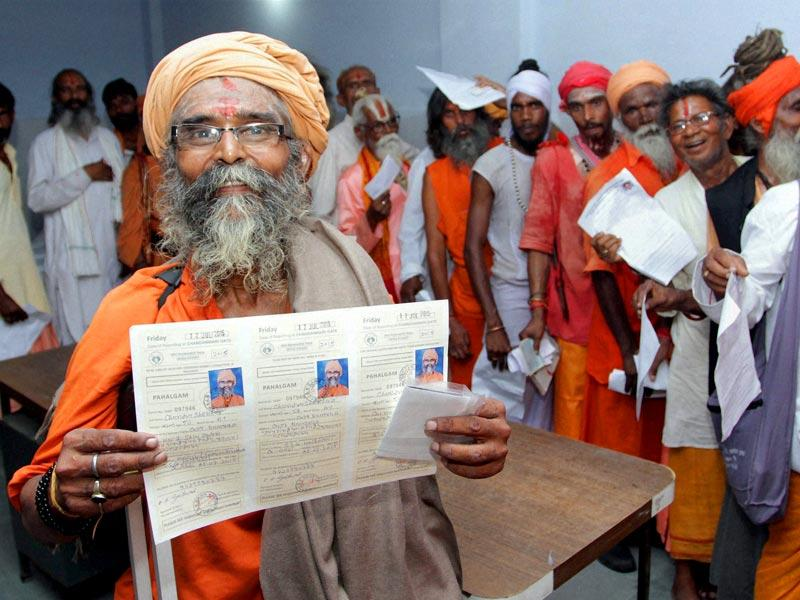 A sadhu displays his registration card for the Amarnath yatra, at the base camp in Jammu. (PTI Photo)