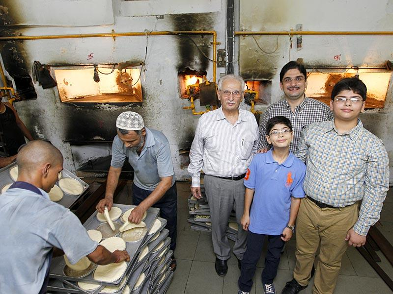 Surat, India - March 21, 2015: The three generations of Dotivala Bakery family pose at their bakery in Surat, India, on Saturday, March 21, 2015. (Photo by Gurinder Osan/ Hindustan Times)