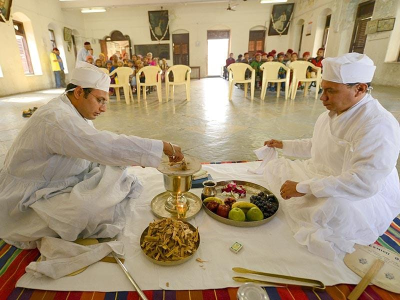 Surat, India - March 21, 2015: Parsi priests prepare for a prayer session on Navroz, the Parsi New Year, at a welfare home in Surat, India, on Saturday, March 21, 2015. (Photo by Gurinder Osan/ Hindustan Times)