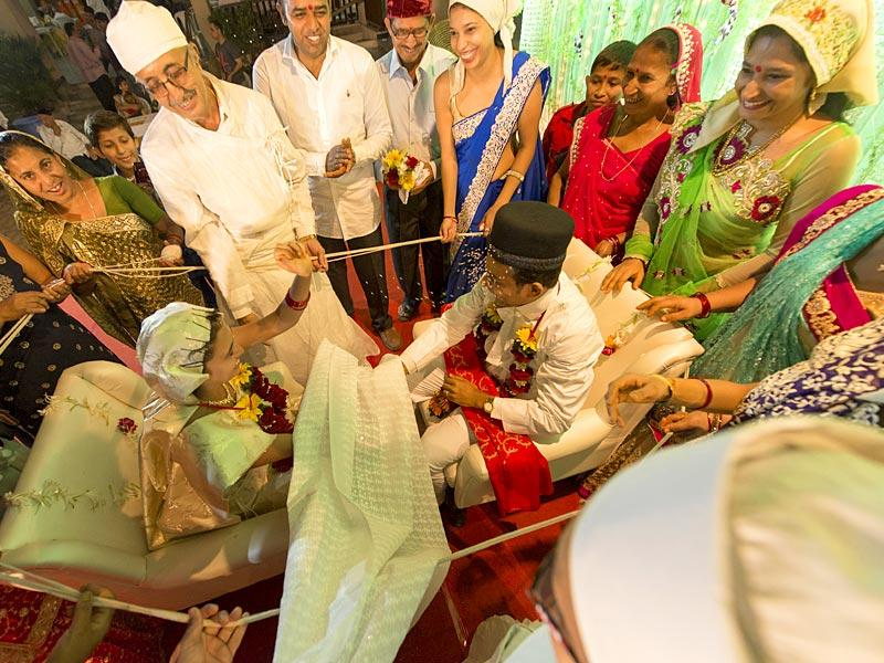 Navsari, India - March 21, 2015: A priest and members of the family gather around for a wedding ceremony in Navsari, India, on Saturday, March 21, 2015. (Photo by Gurinder Osan/ Hindustan Times)