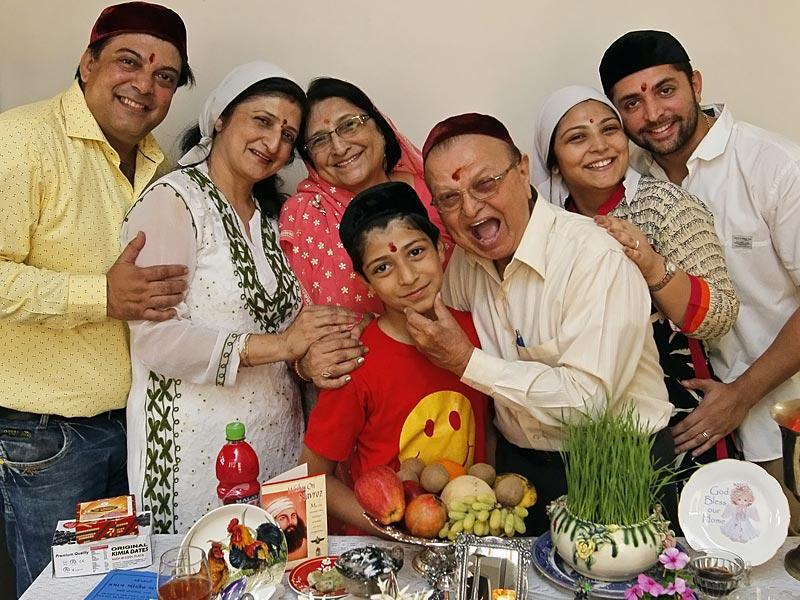 Surat, India - March 21, 2015: Surat's distinguished Yezdi Karanjia family poses next to a table laid out with; the Parsi special feast on Navroz, the Parsi New Year, in Surat, India, on Saturday, March 21, 2015. (Photo by Gurinder Osan/ Hindustan Times)