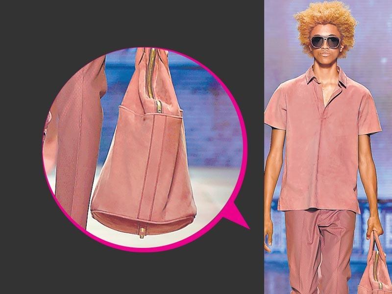 Get your travel style spring-ready by matching your pastel outfits with a duffel bag in the same hue, à la this rosy Etro creation.