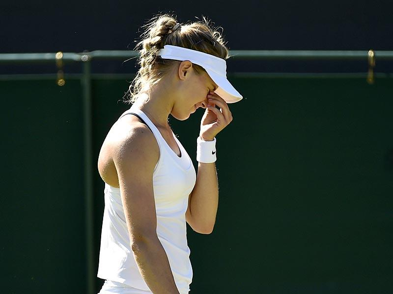 Eugenie Bouchard of Canada reacts during her first-round women's singles match against Ying-Ying Duan of China at the 2015 Wimbledon Championships at The All England Lawn Tennis and Croquet Club in London, on June 30, 2015. Bouchard lost 6-7(3), 4-6. (Reuters Photo)