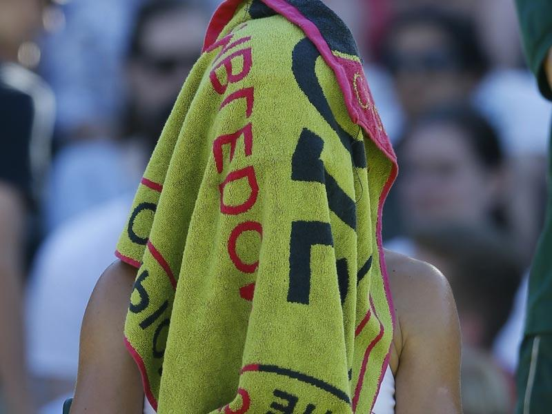Simona Halep of Romania covers her face after losing a service game to Jana Cepelova of Slovakia during the women's singles first-round match at the 2015 Wimbledon Championships at The All England Lawn Tennis and Croquet Club in London, on June 30, 2015. Halep lost 7-5, 4-6, 3-6. (AP Photo)