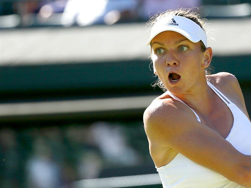 Simona Halep of Romania hits a backhand during her first-round women's singles match against Jana Cepelova of Slovakia at the 2015 Wimbledon Championships at The All England Lawn Tennis and Croquet Club in London, on June 30, 2015. Halep lost 7-5, 4-6, 3-6. (Reuters Photo)
