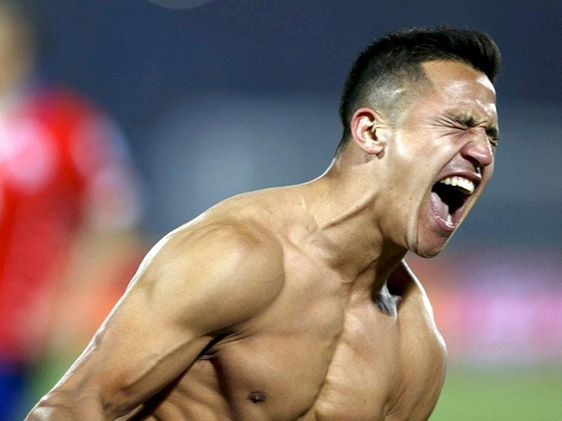 Chile's Alexis Sanchez celebrates after scoring the winning penalty kick.(Reuters Photo)