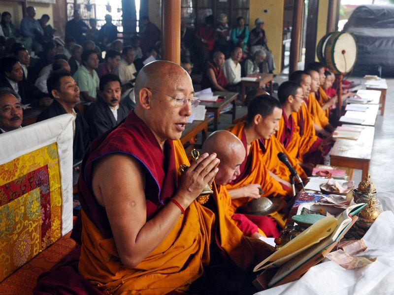 Tibetan monks offering traditional prayer ceremony on 80th birth anniversary of Dalai Lama at Lha Gyari temple in Mcleodganj near Dharamsala on Monday. Shyam Sharma/HT