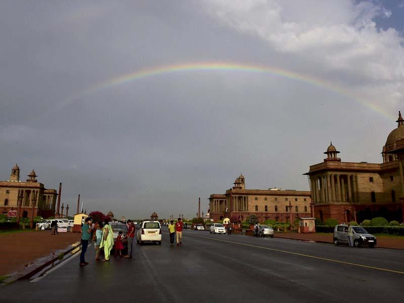 A rainbow appears in the sky above Raisina Hill after rains in New Delhi. (PTI Photo)