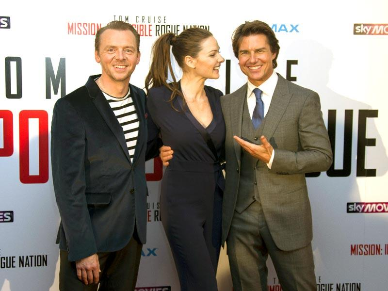 Tom Cruise and his co-stars Rebecca Ferguson and Simon Pegg pose at the UK premiere of Mission Impossible: Rogue Nation. (AP Photo)