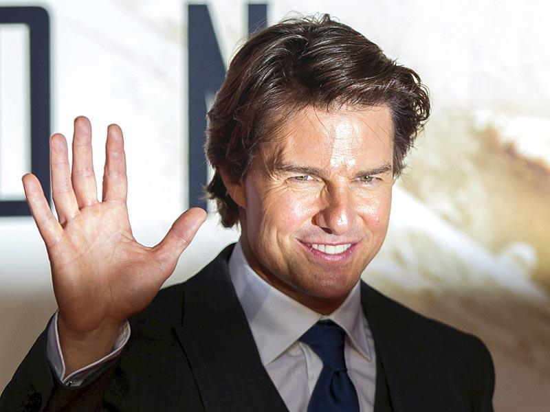 Tom Cruise waves at his fans at the UK premiere of Mission Impossible: Rogue Nation. (Reuters)