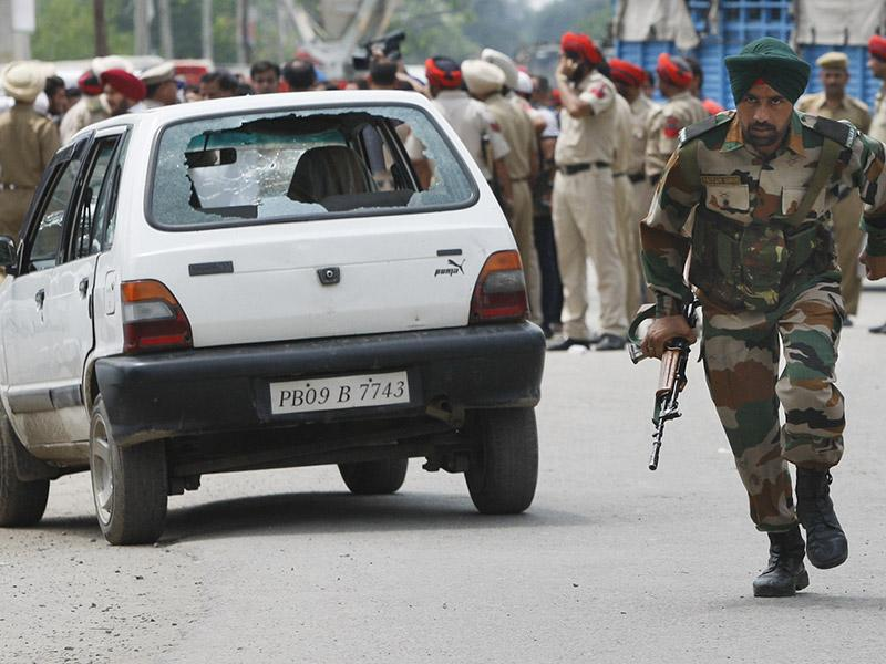Indian army commandos joined police in fighting suspected militants who fired at a bus station and stormed into police barracks on the outskirts of a northern town bordering Pakistan early Monday. (AP Photo)
