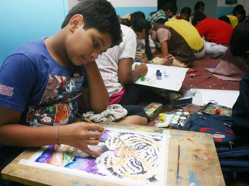 Children participate in a painting competition organized on the occasion of International Tiger Day, in Bhopal on Wednesday. (Bidesh Manna/HT photo)