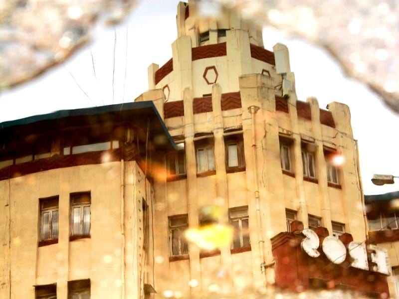 A reflection of Eros Cinema Hall at Churchgate. The Eros Cinema has a cylindrical tower. (HT photo/Sarit Ray)