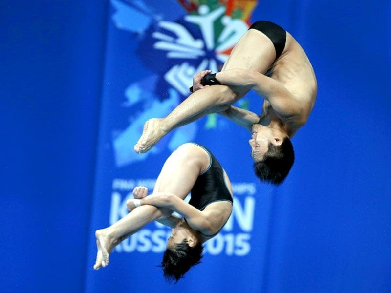 Japan's Minami Itahashi and Yu Okamoto compete in the mixed synchronised 10m platform diving final. (AP Photo)