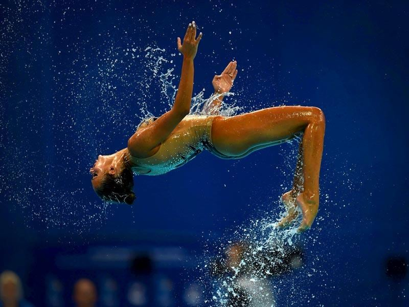 A member of Team Greece competes in the team free combination preliminary event during the synchronised swimming competition. (AFP Photo)