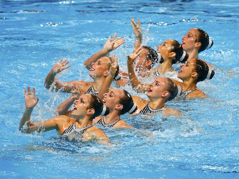Members of Team USA perform in the synchronised swimming team technical final. (Reuters Photo)