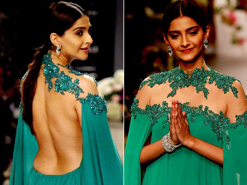 Sonam Kapoor greets as she walks the ramp during a fashion show at the India International Jewellery Week in Mumbai. (AP photo)