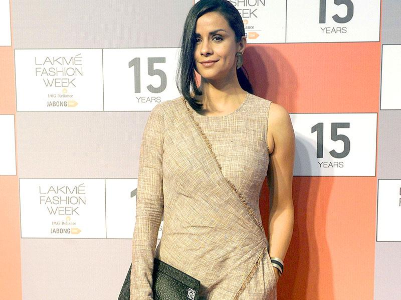Actor Gul Panag is also seen at the press conference. She perhaps wanted to play it safe but decided on this quirky get up. (AFP Photo/ Indranil Mukherjee)