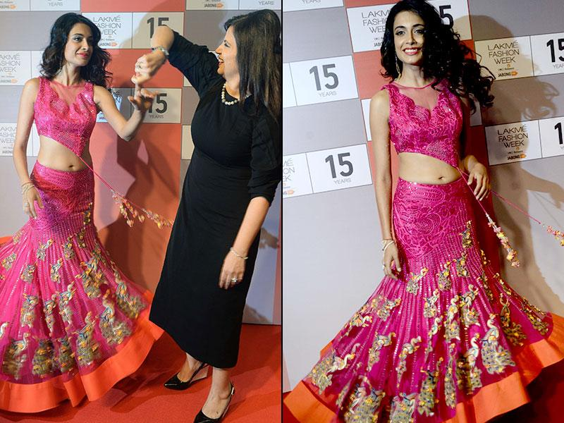Actor Sarah-Jane Dias looks classy in this fuschia pink ethnic ensemble. Designer Neeta Lulla and Sarah-Jane Dias share a candid moment at the press conference. (Left: IANS Photo, Right: AFP Photo/ Indranil Mukherjee)