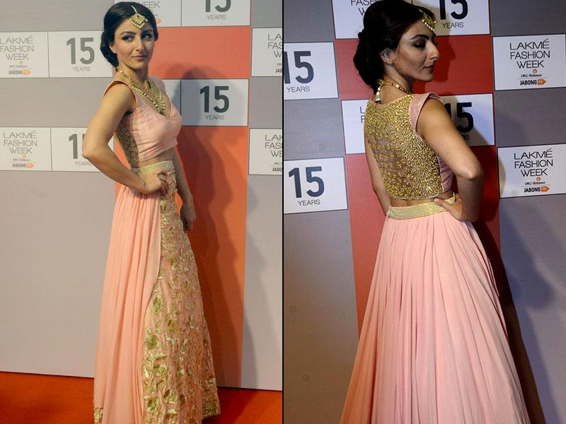 The Lakme Fashion Week 2015 is soon to be unveiled and days before the unveiling, a curtain raiser gives a sneak peek into this year's most awaited Fashion Week. Actor Soha Ali Khan poses at the curtain raiser press conference in Mumbai on August 3, 2015. (Left: IANS Photo, Right: AFP Photo/ Indranil Mukherjee)