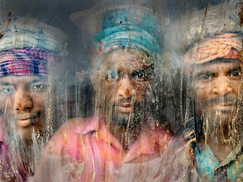 Gravel Workmen | [This] gravel-crush working place remains full of dust and sand. Three gravel workmen are looking through the window glass at their working place. Chittagong, Bangladesh. (Photo and caption by Faisal Azim /National Geographic Traveler Photo Contest Here are the details about the contest http://travel.nationalgeographic.com/photo-contest-2015/)