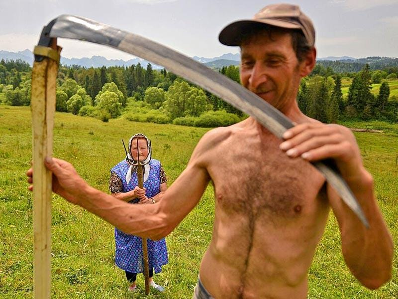 Highlanders | Traditional haymaking in Poland. Many people continue to use the scythe and pitchfork to sort the hay. ( Photo and caption by Bartlomiej Jurecki /National Geographic Traveler Photo Contest. Here are the details about the contest http://travel.nationalgeographic.com/photo-contest-2015/)