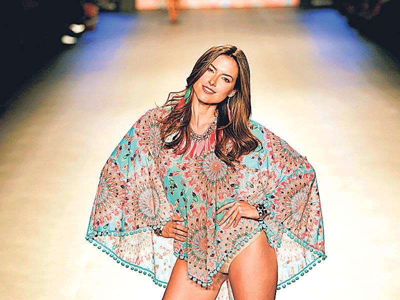For a beach vacation, take inspiration from this colourful boho cape by label Luli Fama on the Colombian ramp.
