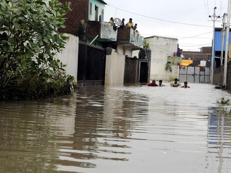 Rainwater submerged houses in Indore's New Bajrangpura on Wednesday. People had to climb upstairs and stay put till the water receded. (Arun Mondhe/HT)