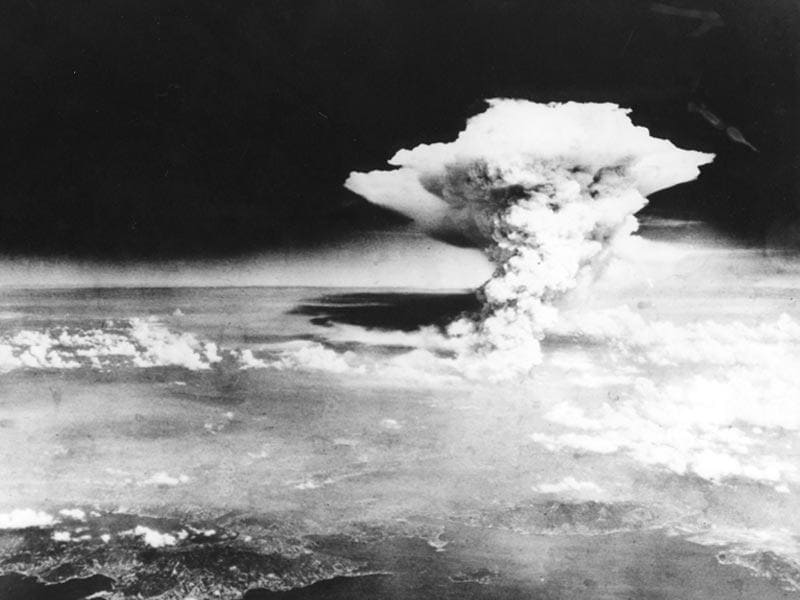 This handout picture taken on August 6, 1945 by US Army and released from Hiroshima Peace Memorial Museum shows a mushroom cloud of the atomic bomb dropped by B-29 bomber Enola Gay over the city of Hiroshima. (AFP Photo / HIROSHIMA PEACE MEMORIAL MUSEUM)
