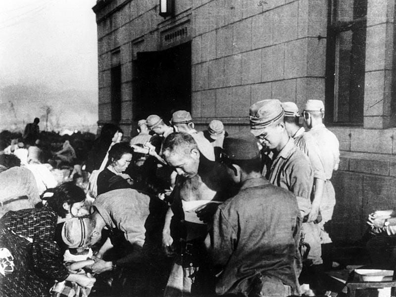 In this Aug 6, 1945 file photo, shortly after the first atomic bomb ever used in warfare was dropped by the United States over the Japanese city of Hiroshima, survivors are seen as they receive emergency treatment by military medics in Hiroshima, Japan. (AP Photo)