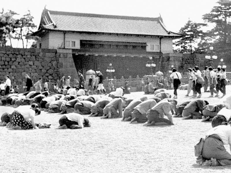 In this Aug 15, 1945 photo, Japanese people kneel in front of the Imperial Palace in Tokyo as Emperor Hirohito announced on radio that Japan was defeated in the World War II.(Kyodo New via AP)