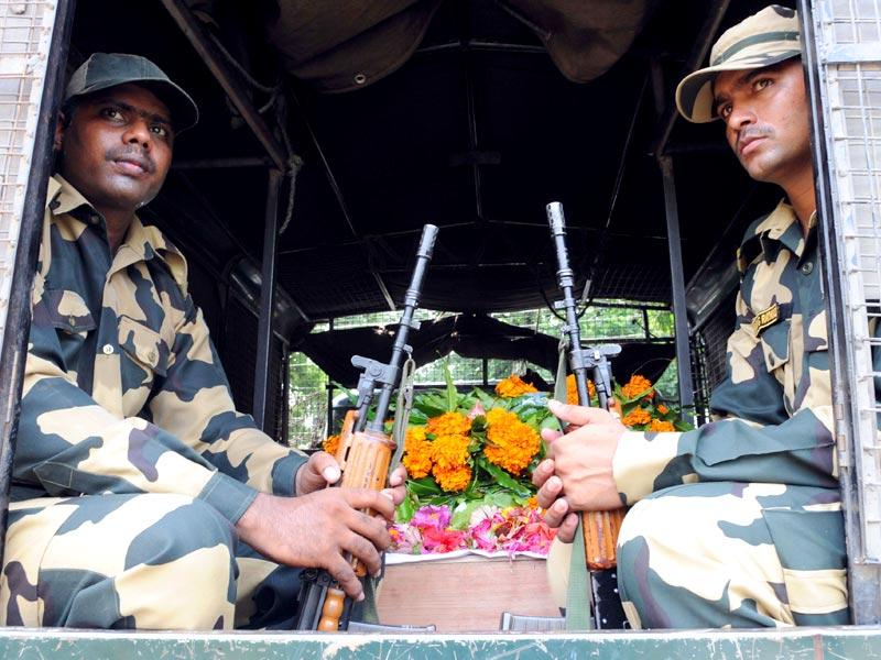 BSF officers and soldiers carrying the coffin of Subhendu Rai after paying tribute in Jammu. (Nitin Kanotra/HT Photo)