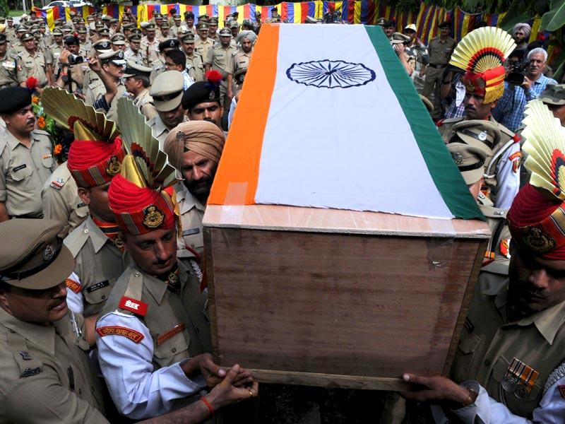 BSF officers and soldiers carrying the coffin of Subhendu Rai after paying tribute to the martyr in Jammu. (Nitin Kanotra/HT Photo)