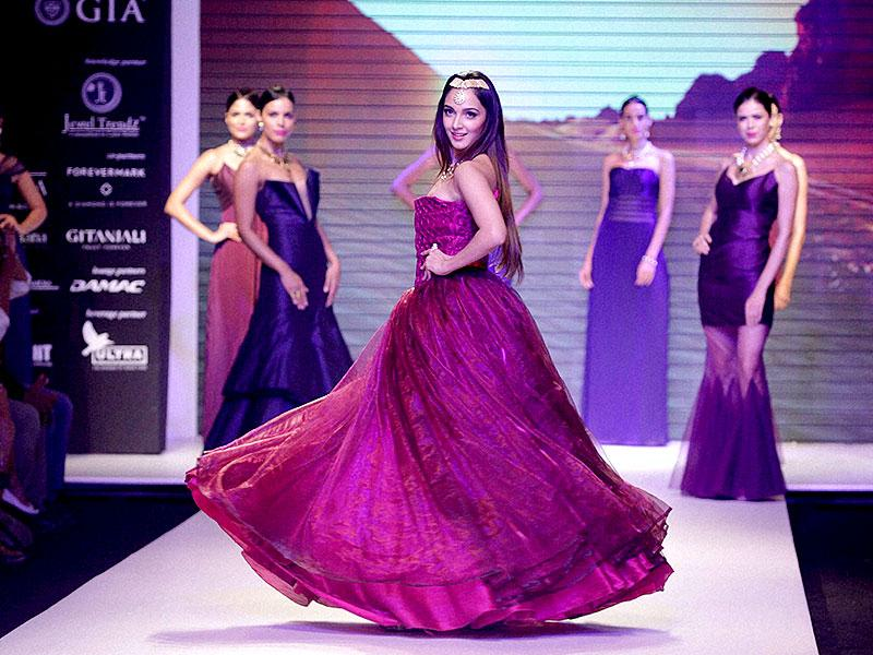 Kiara Advani displays a creation during the fashion show. (Photo: AP)