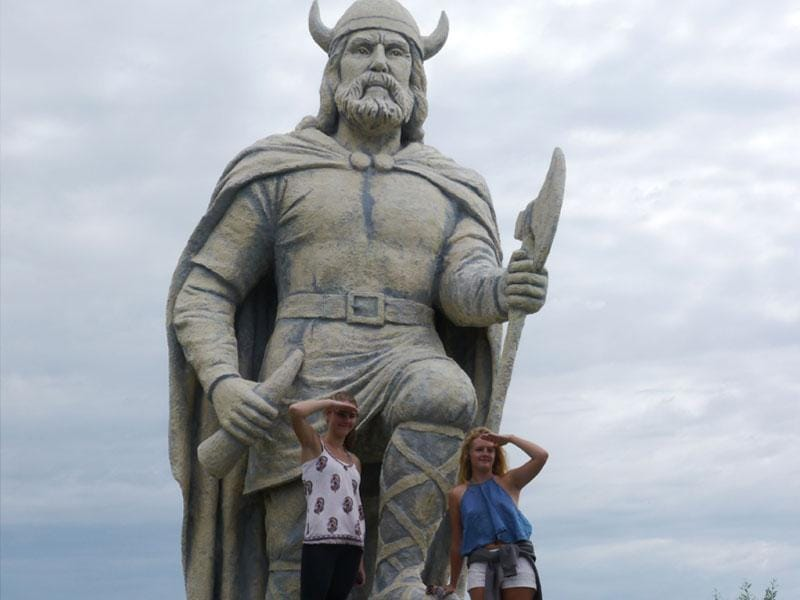 Women stand on a Viking statue at the Icelandic Festival in Gimli, Manitoba. Vikings were famous fighters. (AFP Photo/ Thibault Jourdan)