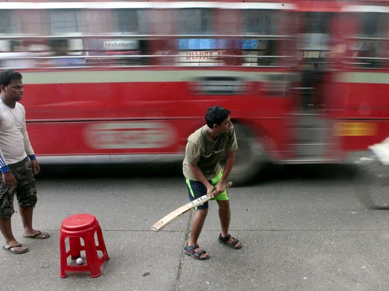 Young boys play cricket on the street of Mumbai. (Pratham Gokhale/HT photo)